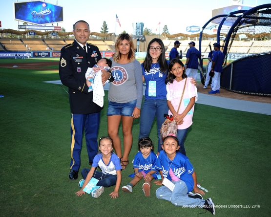 Los Angeles Dodgers Military Hero of the game, U.S. Army Staff Sergeant, Dagoberto Moreno, Jr and family pose prior to game against the Arizona Diamondbacks Tuesday, September 6, 2016 at Dodger Stadium. Photo by Jon SooHoo/©Los Angeles Dodgers,LLC 2016