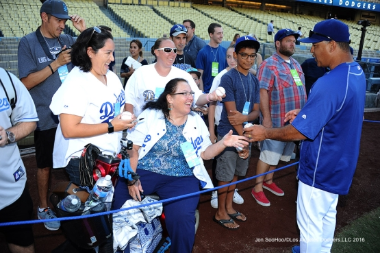 Dave Roberts signs for fans prior to game against the Arizona Diamondbacks Tuesday, September 6, 2016 at Dodger Stadium. Photo by Jon SooHoo/©Los Angeles Dodgers,LLC 2016