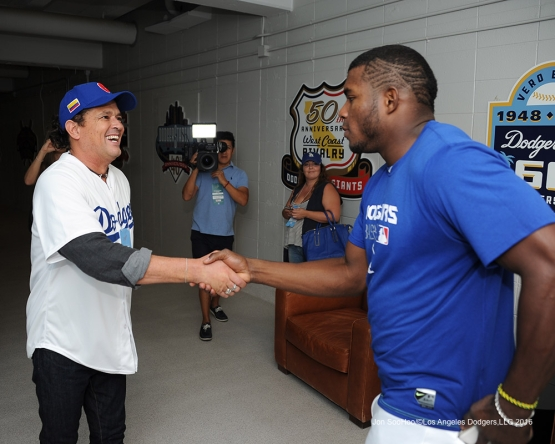 Columbia's popular musician Carlos Vives is greeted by Yasiel Puig prior to game against the Arizona Diamondbacks Tuesday, September 6, 2016 at Dodger Stadium. Photo by Jon SooHoo/©Los Angeles Dodgers,LLC 2016