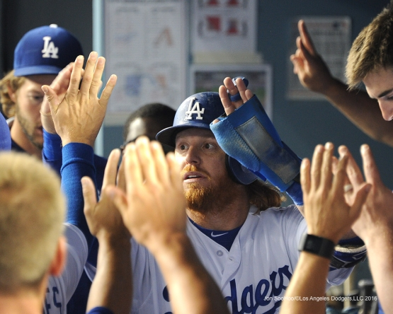 Justin Turner greeted in the dugout during game against the Arizona Diamondbacks Tuesday, September 6, 2016 at Dodger Stadium. Photo by Jon SooHoo/©Los Angeles Dodgers,LLC 2016