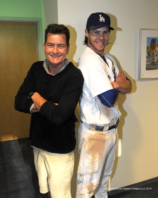 Charlie Sheen with Josh Reddick after Dodgers win against the Arizona Diamondbacks Tuesday, September 6, 2016 at Dodger Stadium. Photo by Jon SooHoo/©Los Angeles Dodgers,LLC 2016