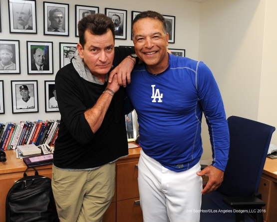 Dave  Roberts with Charlie Sheen after win against the Arizona Diamondbacks Tuesday, September 6, 2016 at Dodger Stadium. Photo by Jon SooHoo/©Los Angeles Dodgers,LLC 2016