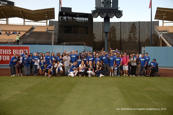 Los Angeles Dodgers fans who rode the Metro Bus to the game pose with Olympic Gold medal winning U.S. Women;s Water Polo team members prior to game against the Arizona Diamondbacks Wednesday, September 7, 2016 at Dodger Stadium. Photo by Jon SooHoo/©Los Angeles Dodgers,LLC 2016