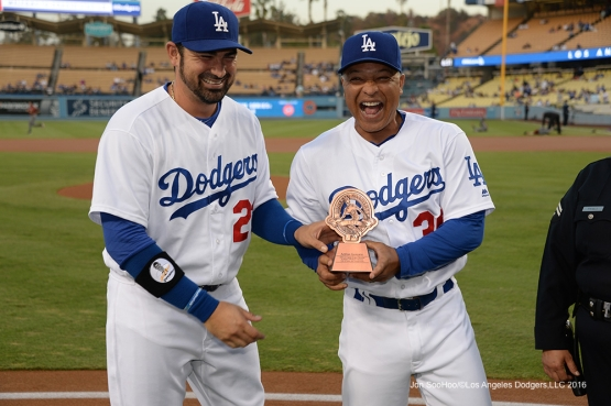Adrian Gonzalez laughs with Dave Roberts prior to winning the Roberto Clemente award representing the Dodgers Wednesday, September 7, 2016 at Dodger Stadium. Photo by Jon SooHoo/©Los Angeles Dodgers,LLC 2016
