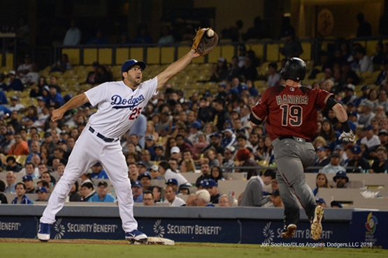 Rob Segedin makes play at first against the Arizona Diamondbacks Wednesday, September 7, 2016 at Dodger Stadium. Photo by Jon SooHoo/©Los Angeles Dodgers,LLC 2016