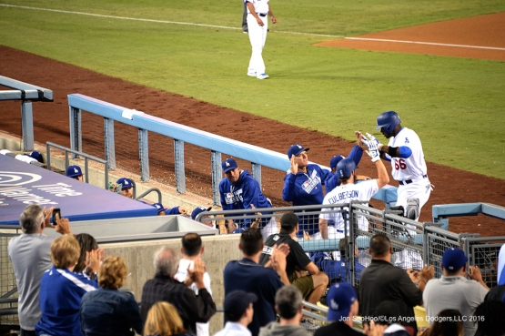 Yasiel Puig is greeted by team after homer against the Arizona Diamondbacks Wednesday, September 7, 2016 at Dodger Stadium. Photo by Jon SooHoo/©Los Angeles Dodgers,LLC 2016