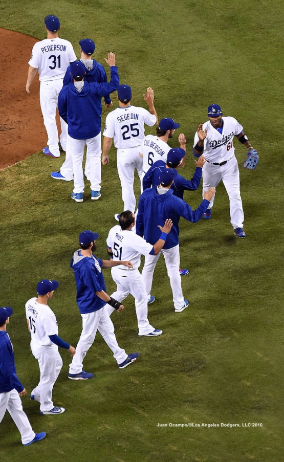 The Dodgers celebrate their 3-1 win over the Diamondbacks.