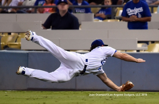 Charlie Culberson stretches out attempting to catch the ball.