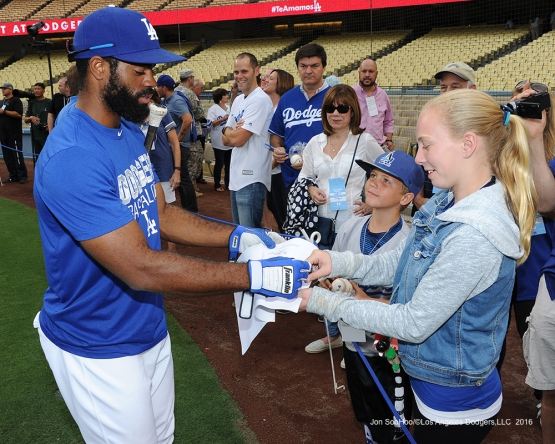 Andrew Toles signs for fans prior to game against the San Francisco Giants Monday, September 19, 2016 at Dodger Stadium. Photo by Jon SooHoo/©Los Angeles Dodgers,LLC 2016