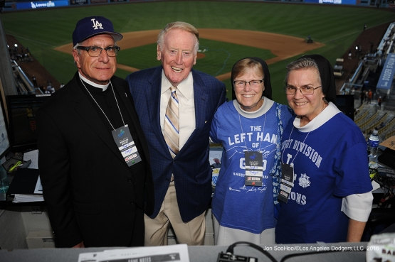 Guests of Vin pose prior to game against the San Francisco Giants Monday, September 19, 2016 at Dodger Stadium. Photo by Jon SooHoo/©Los Angeles Dodgers,LLC 2016