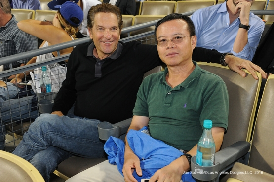 Peter  Guber and friend pose during game against the San Francisco Giants Monday, September 19, 2016 at Dodger Stadium. Photo by Jon SooHoo/©Los Angeles Dodgers,LLC 2016