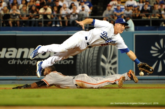 Chase Utley dives for ball  during game against the San Francisco Giants Monday, September 19, 2016 at Dodger Stadium. Photo by Jon SooHoo/©Los Angeles Dodgers,LLC 2016