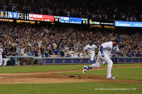 Justin Turner scores Andrew Toles  to tie the game in the ninth against the San Francisco Giants Monday, September 19, 2016 at Dodger Stadium. Photo by Jon SooHoo/©Los Angeles Dodgers,LLC 2016