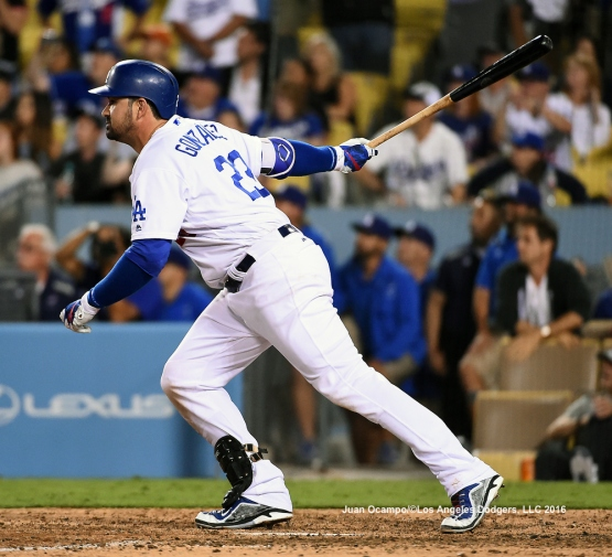 Adrian Gonzalez knocks in the winning run in the ninth inning.
