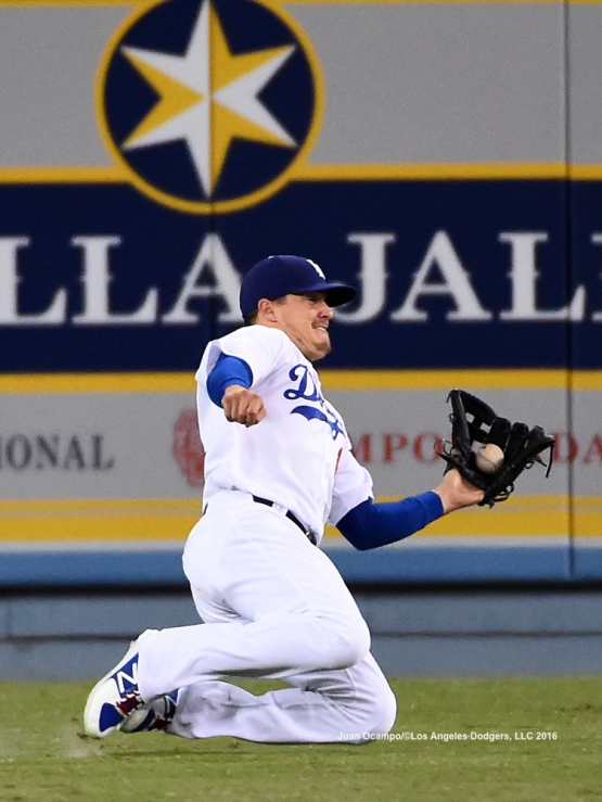 Enrique Hernandez makes the sliding catch in centerfield.