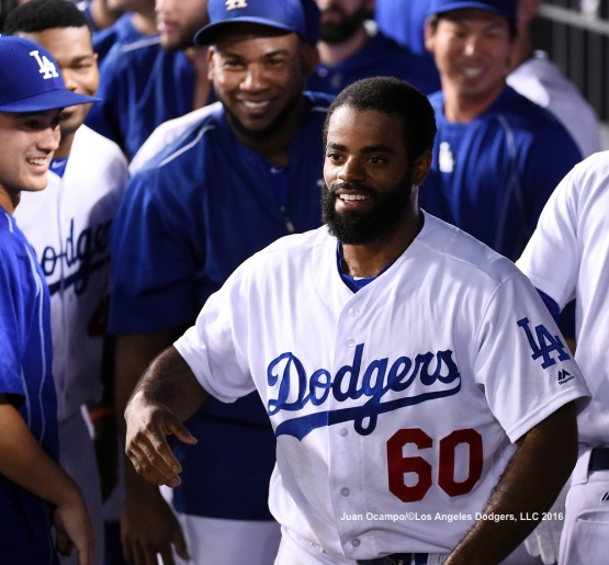 Andrew Toles smiles in the dugout after scoring the tying run in the ninth inning.