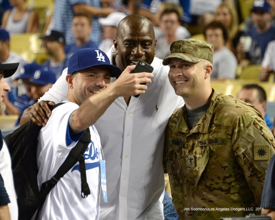 "Great Dodger fans pose with Earvin ""Magic"" Johnson prior to game against the San Francisco Giants Tuesday, September 20, 2016 at Dodger Stadium. Photo by Jon SooHoo/©Los Angeles Dodgers,LLC 2016"