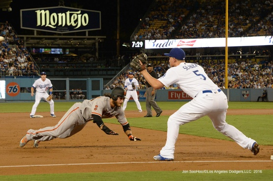 Corey Seager makes the tag on Giants Brandon Crawford on throw from left fielder Andrew Toles Tuesday, September 20, 2016 at Dodger Stadium. Photo by Jon SooHoo/©Los Angeles Dodgers,LLC 2016