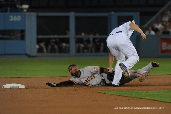 Corey Seager makes the tag during game against the San Francisco Giants Tuesday, September 20, 2016 at Dodger Stadium. Photo by Jon SooHoo/©Los Angeles Dodgers,LLC 2016
