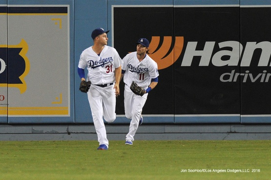 Joc Pederson and Josh Reddick head to the dugout during game against the San Francisco Giants Tuesday, September 20, 2016 at Dodger Stadium. Photo by Jon SooHoo/©Los Angeles Dodgers,LLC 2016