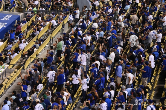 Great Los Angeles Dodger fans stand during game against the San Francisco Giants Tuesday, September 20, 2016 at Dodger Stadium. Photo by Jon SooHoo/©Los Angeles Dodgers,LLC 2016