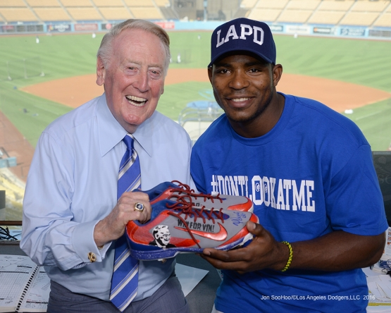Vin Scully and Yasiel Puig pose prior to game against the San Francisco Giants Wednesday, September 21, 2016 at Dodger Stadium. Photo by Jon SooHoo/©Los Angeles Dodgers,LLC 2016