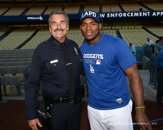 Yasiel Puig with LAPD Chief Charlie Beck prior to game against the San Francisco Giants Wednesday, September 21, 2016 at Dodger Stadium. Photo by Jon SooHoo/©Los Angeles Dodgers,LLC 2016