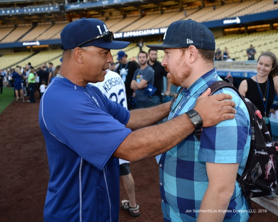 Dave Roberts talks with friend prior to game against the San Francisco Giants Wednesday, September 21, 2016 at Dodger Stadium. Photo by Jon SooHoo/©Los Angeles Dodgers,LLC 2016