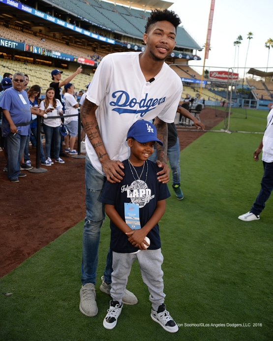 Los Angeles Laker Brandon Ingram and young fan pose prior to game against the San Francisco Giants Wednesday, September 21, 2016 at Dodger Stadium. Photo by Jon SooHoo/©Los Angeles Dodgers,LLC 2016