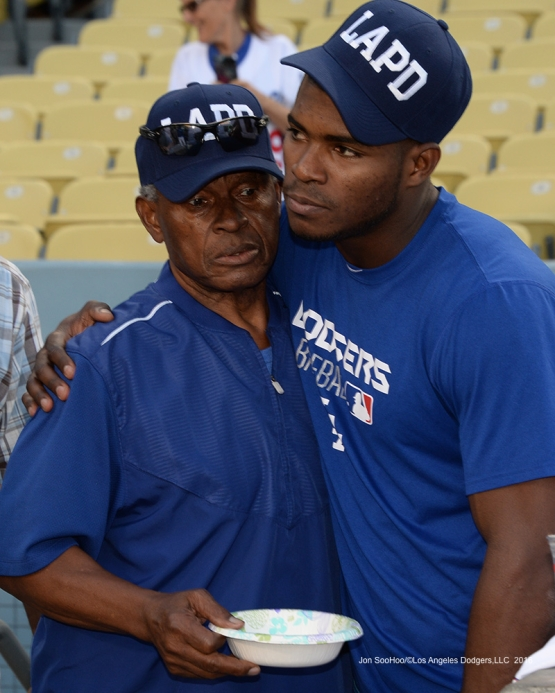 Yasiel Puig and Manny Mota chat prior to game against the San Francisco Giants Wednesday, September 21, 2016 at Dodger Stadium. Photo by Jon SooHoo/©Los Angeles Dodgers,LLC 2016