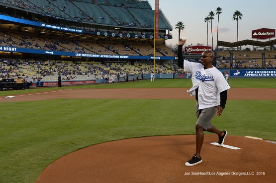 Eric Dickerson throws out the first pitch prior to game against the San Francisco Giants Wednesday, September 21, 2016 at Dodger Stadium. Photo by Jon SooHoo/©Los Angeles Dodgers,LLC 2016