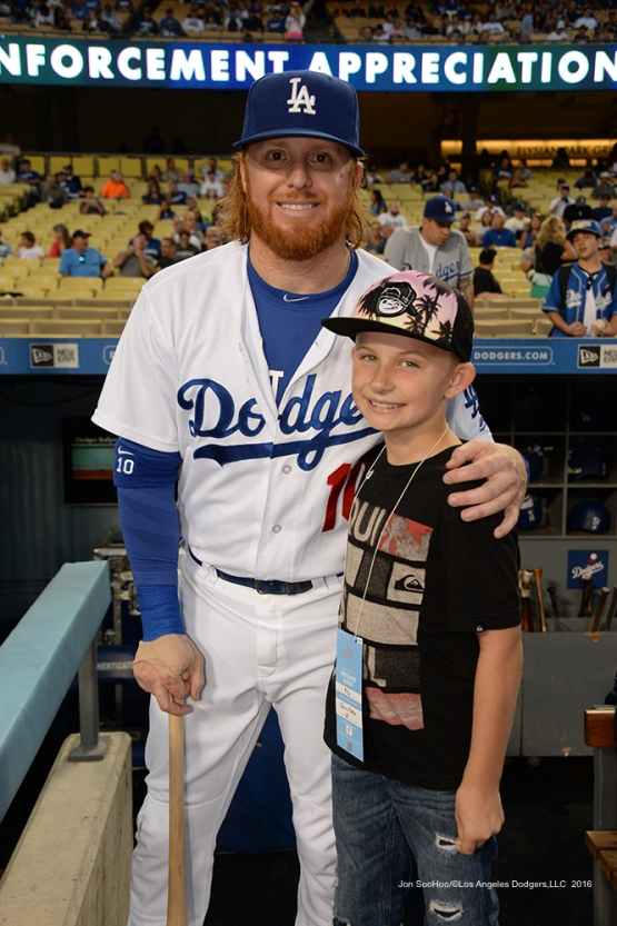 Justin Turner poses with fan prior to game against the San Francisco Giants Wednesday, September 21, 2016 at Dodger Stadium. Photo by Jon SooHoo/©Los Angeles Dodgers,LLC 2016