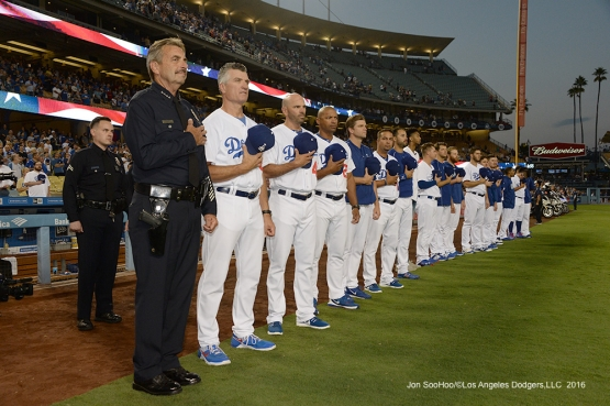 Los Angeles Police Department Chief Charlie Beck joins the Los Angeles Dodgers on the line for the national anthem prior to game against the San Francisco Giants Wednesday, September 21, 2016 at Dodger Stadium. Photo by Jon SooHoo/©Los Angeles Dodgers,LLC 2016