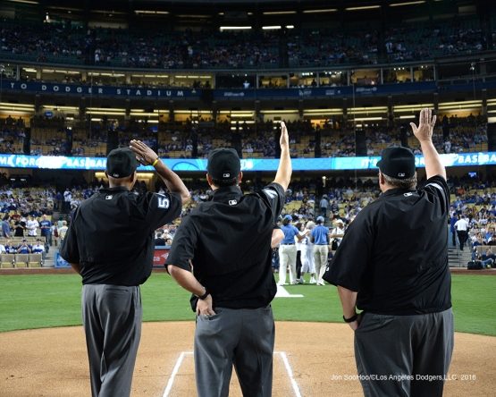 The Umpires wave to Vin Scully during game against the San Francisco Giants Wednesday, September 21, 2016 at Dodger Stadium. Photo by Jon SooHoo/©Los Angeles Dodgers,LLC 2016