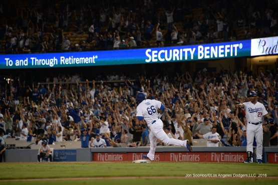 Yasiel Puig hits three run homer in the first inning against the San Francisco Giants Wednesday, September 21, 2016 at Dodger Stadium. Photo by Jon SooHoo/©Los Angeles Dodgers,LLC 2016