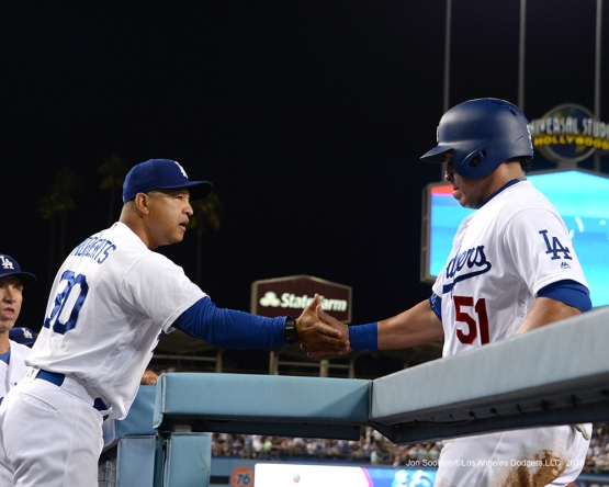 Carlos Ruiz is greeted by Dave Roberts after scoring during game against the San Francisco Giants Wednesday, September 21, 2016 at Dodger Stadium. Photo by Jon SooHoo/©Los Angeles Dodgers,LLC 2016