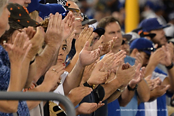 Hands of fans during game against the San Francisco Giants Wednesday, September 21, 2016 at Dodger Stadium. Photo by Jon SooHoo/©Los Angeles Dodgers,LLC 2016
