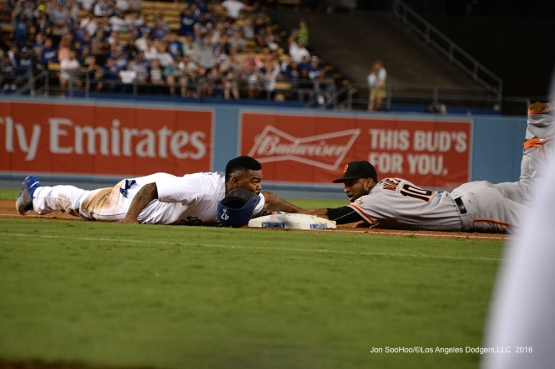 Howie Kendrick is safe at third during game against the San Francisco Giants Wednesday, September 21, 2016 at Dodger Stadium. Photo by Jon SooHoo/©Los Angeles Dodgers,LLC 2016