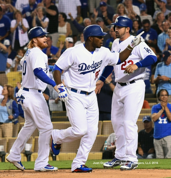 Yasiel Puig points to the stands after his home run.