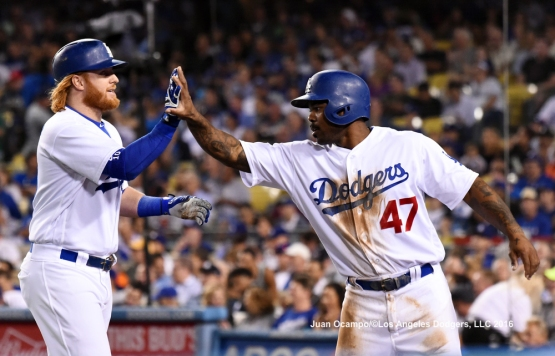 Justin Turner scores Howie Kendrick on a sacrifice fly in the second inning.