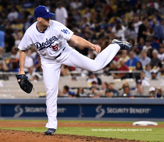 Alex Wood pitches in relief.