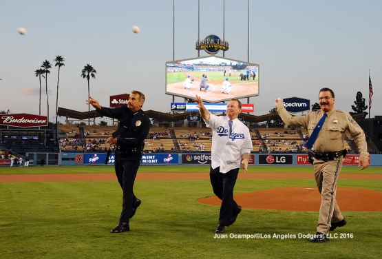 LAPD Chief Charlie Beck, LA County Sheriff Jim McDonnell and California Highway Patrol Chief Bill Siegl, throw out the ceremonial first pitch.