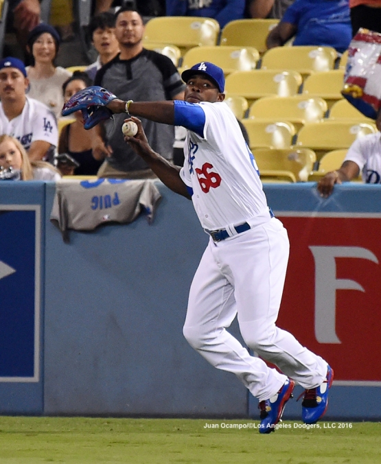 Yasiel Puig gets set to make the throw to home in the first inning.
