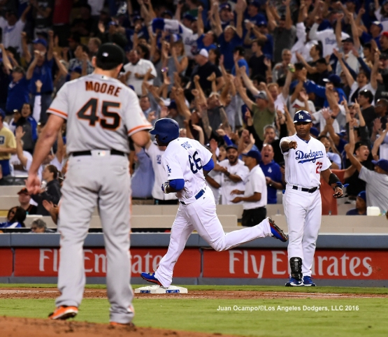 Yasiel Puig rounds the bases after hitting a three-run homer off Giants starter Matt Moore in the first inning.