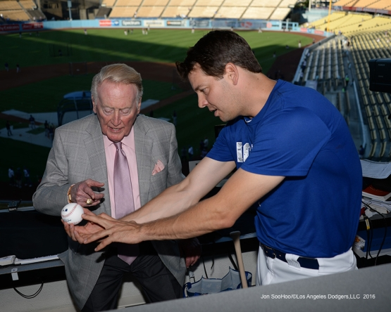 Rich Hill shows Vin Scully his grip Thursday, September 22, 2016 at Dodger Stadium. Photo by Jon SooHoo/©Los Angeles Dodgers,LLC 2016