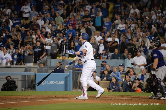 Yasmani Grandal watches his grand slam ball fly over the wall during game against the Colorado Rockies Thursday, September 22, 2016 at Dodger Stadium. Photo by Jon SooHoo/©Los Angeles Dodgers,LLC 2016