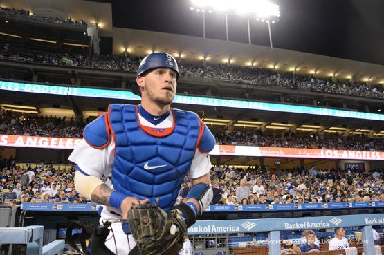 Yasmani Grandal takes the field after hitting his grand slam against the Colorado Rockies Thursday, September 22, 2016 at Dodger Stadium. Photo by Jon SooHoo/©Los Angeles Dodgers,LLC 2016