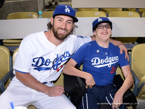 Charlie Culberson poses with a fan after the  game against the Colorado Rockies Thursday, September 22, 2016 at Dodger Stadium. Photo by Jon SooHoo/©Los Angeles Dodgers,LLC 2016