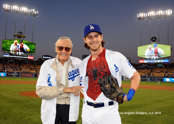Stan Lee, American comic-book writer and former president and chairman of Marvel Comics, and Josh Reddick pose for a photo after the ceremonial first pitch.