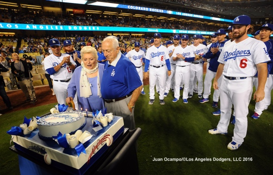 The Dodgers take part in celebrating Tommy Lasorda's birthday before the game against the Rockies.